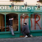 A glazier works on the damage to Fianna Fail Transport Minister Noel Dempsey TD's constituency office in Trim, Meath. Windows were smashed and the word 'Traitors' was sprayed on it overnight.