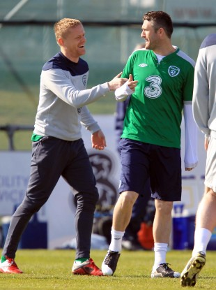 Damien Duff and Robbie Keane share a joke at Gannon Park yesterday.