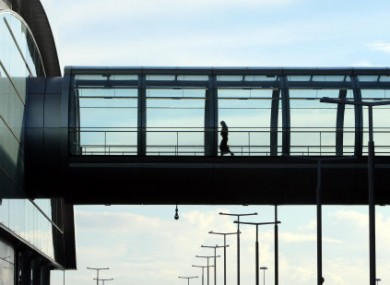 A passenger crosses a walkway at Dublin Airport - an average of 12 women a day are travelling from Ireland to England and Wales for abortions