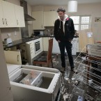 David Cahill in his kitchen off Parnell Road, Dublin 8. The waterline of the flood is visable behind him. Image: Mark Stedman/Photocall Ireland