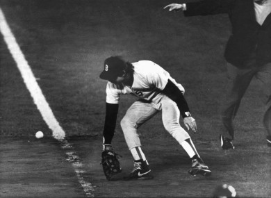 Boston Red Sox first baseman Bill Buckner misplays the ball during Game 6 of the 1986 World Series against the New York Mets.