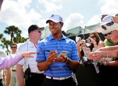 Tiger Woods signs autographs during a practice round for the Honda Classic.