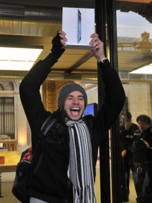 Craig Jobbins, from Romford, celebrates getting one of the first new Apple iPads at the company's Covent Garden store on the release of the latest version of the tablet computer on Friday.