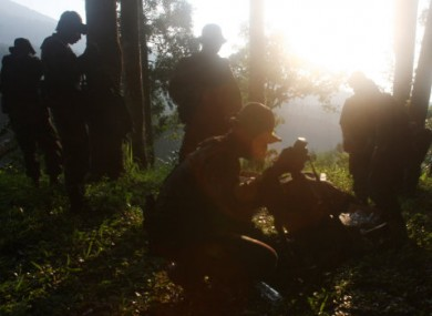 Indonesian soldiers get ready to find the location of a plane crash at Taman Nasional Halimun Salak in Sukabumi, West Java.