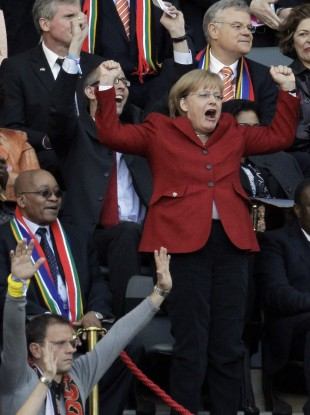 Angela Merkel celebrates next to South African President Jacob Zuma during the 2010 World Cup.