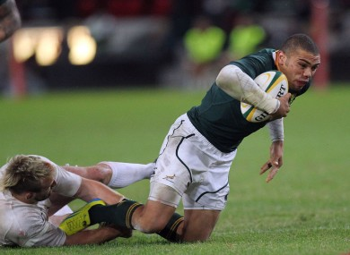 South Africa's Bryan Habana is tackled by England's Joe Marler