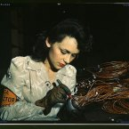 Original caption: Woman aircraft worker, Vega Aircraft Corporation, Burbank, Calif. Shown checking electrical assemblies. Photo: David Bransby