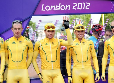 Cadel Evans (centre) with his Australian teammates before yesterday's road race.