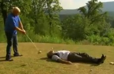 VIDEO: John Daly hits a drive with David Feherty acting as a human tee