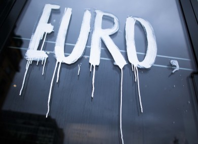 The word (painted on the window of the Academy of Arts in Berlin) is part of the slogan 'Wenn der Euro scheitert, scheitert Europa' (When the Euro collapses, Europe collapses) designed by the artist group Bureau Mario Lombardo.