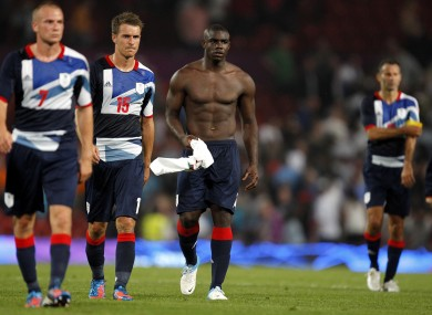 Great Britain's Tom Cleverley, Aaron Ramsey and Micah Richards are dejected after the game.