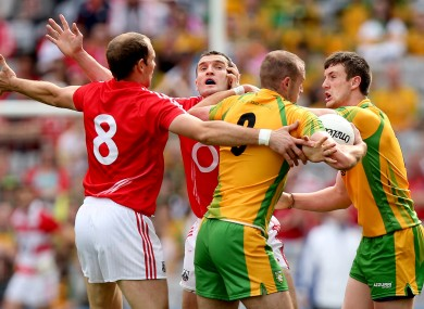 Cork's Alan O'Connor and Graham Canty with Neil Gallagher and Leo McLoone of Donegal.