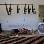 A Syrian rebel sleeps at a rebel HQ in Marea after returning back from fighting against army forces in Aleppo. (AP Photo/Muhammed Muheisen)