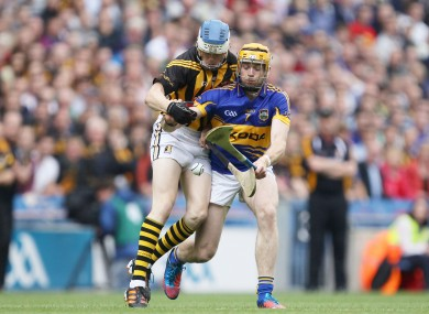 Tipperary's Padraic Maher and TJ Reid of Kilkenny battle for possession.