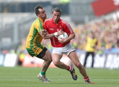 Cork's Patrick Kelly with Karl Lacey of Donegal.