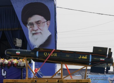 Supreme leader Ayatollah Ali Khamenei and missile