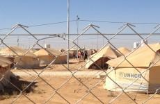 Minister visits refugee camp in Jordan as Syrian rebels 'shoot down' helicopter in Damascus