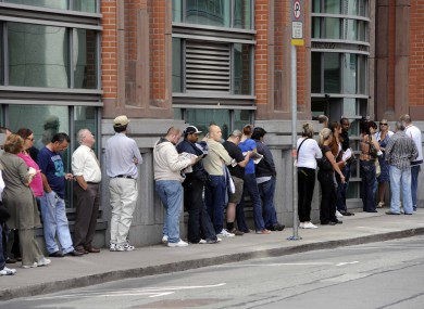 Members of the public queue outside the Social We