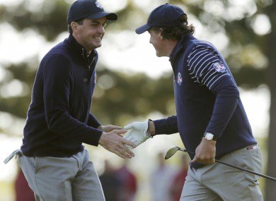 Phil Mickelson, right, and Keegan Bradley react on the seventh hole.