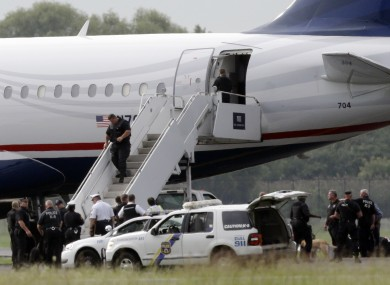 Law enforcement at the plane when it returned to the airport in Philadelphia today.