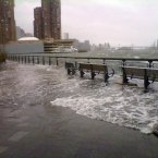 A member of the public's photograph taken with a camera phone of the East River on the Manhattan side in New York, USA as Hurricane Sandy bore down on the US East Coast, threatening to bring an 11ft (3.4-metre) storm surge to the city.