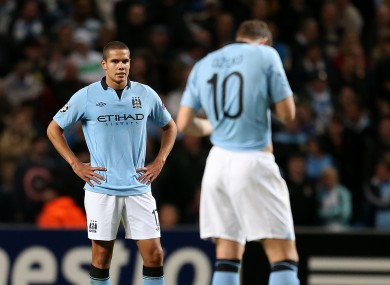 Manchester City's Jack Rodwell stands dejected after his mistake led to Borussia Dortmund's first goal.