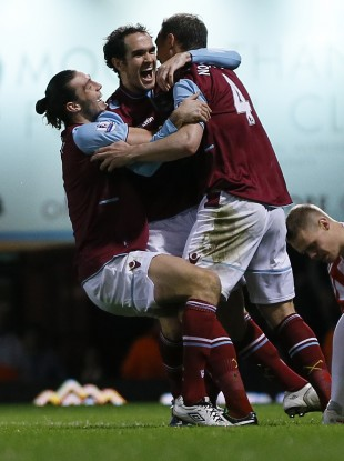 O'Brien is congratulated by Andy Carroll and Kevin Nolan.