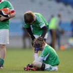 Iain O'hEithir consoles his teammate Colm Mac Giolla Phadraig after defeat to Gaelscoil Cholmcille.