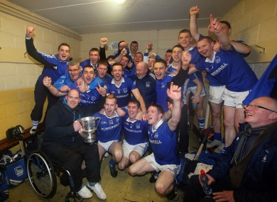 Thurles Sarsfields' players celebrate with the Bob O'Neill cup in the dressing-room after the game.