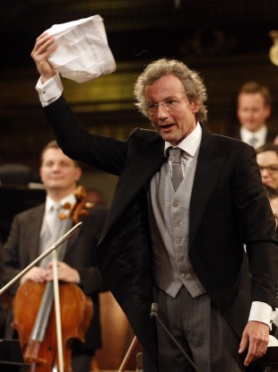 Austrian maestro Franz Welser-Moest conducts the Vienna Philharmonic Orchestra with a cap during a rehearsal for the traditional New Year's concert.