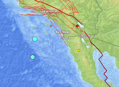 The two blue dots show the epicentres of the two earthquakes that struck off California and Mexico in the last half-hour.