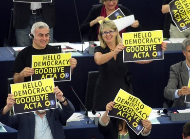 Green MEPs cheer after the European Parliament voted down the controversial Anti-Counterfeit Trade Agreement.