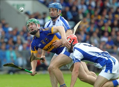 Tipperary's Noel McGrath tackled by Michael Walsh and Stephen Daniels of Waterford in the Munster final.