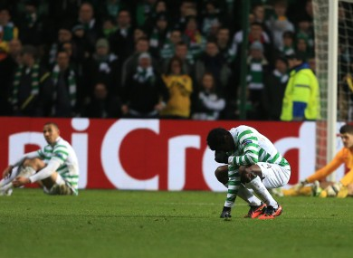 Celtic's Efe Ambrose stands dejected after Juventus' third goal.