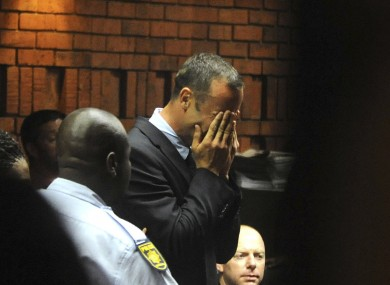 Athlete Oscar Pistorius weeps in court in Pretoria, South Africa.