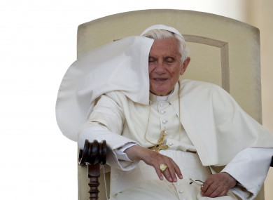 Here's one thing an ex-pope doesn't have to deal with: flyaway capes.