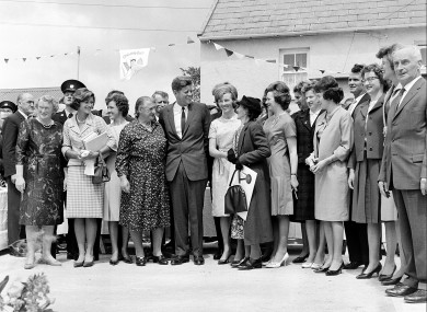 During his three-day visit to Ireland, U.S. President John F. Kennedy meets with his Irish cousins in the barnyard of their mutual forefather's homestead, at Dunganstown, June 27, 1963.