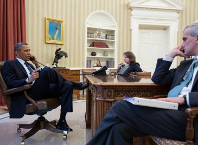 President Obama talks on the phone with FBI Director Mueller to receive an update on the explosions.
