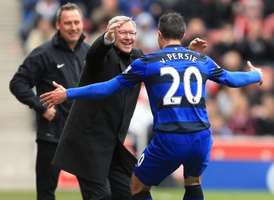 Manchester United's manager Sir Alex Ferguson celebrates with Robin Van Persie after scoring their second goal.