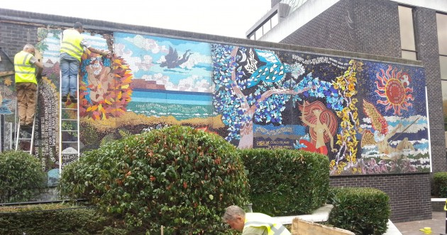 Historical mural ripped off Irish Life building and put in black bags