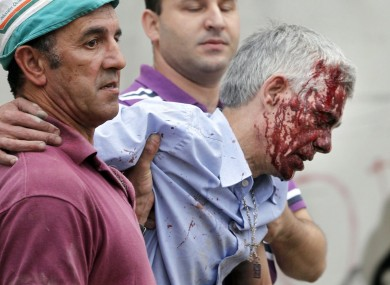Francisco Jose Garzon Amo is helped by two men immediately after the crash last Wednesday