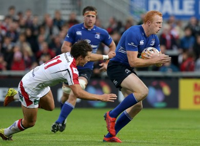 Ulster's Michael Allen grasps for Darragh Fanning of Leinster.