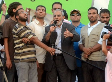 Mohammed Badie speaks to a Cairo crowd in July