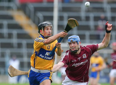 Galway's Barry Keane and Cathal O'Connell of Clare fight for possession during the first half of their All-Ireland U21 hurling semi final.
