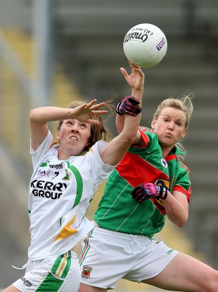 Kerry's Denise Hallissey and Fiona McHale of Mayo battle for possession in the air.