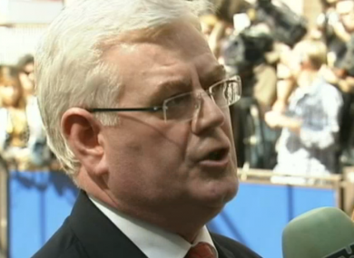 Eamon Gilmore speaking to the media in Brussels today