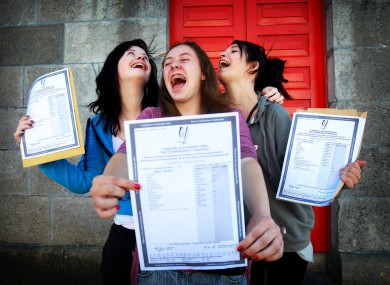 Three students with their results outside Mercy Heights Secondary School in Skibbereen in Cork in August 2011