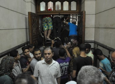 Pro-Muslim Brotherhood supporters shove furniture against the doors to stop anyone from breaking into the mosque.