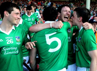 Limerick's Paudie O'Brien, Seamus Hickey and Seanie Tobin celebrate the Munster Final win.