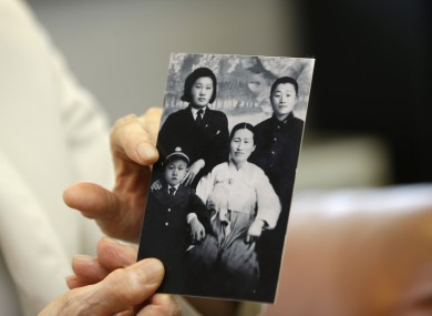 South Korean man Cho Il Woong, 81, shows his family photo in North Korea.